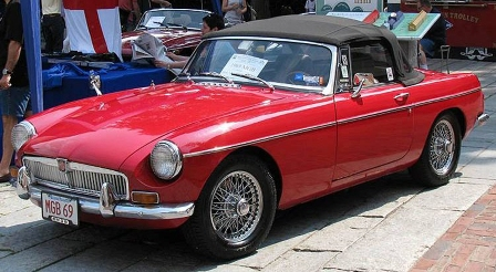 """r. Dean Saluti's 1969 MGB, the """"Red Jewel,"""" on display at the Boston Area MG Club Faneuil Hall British Car Day event."""